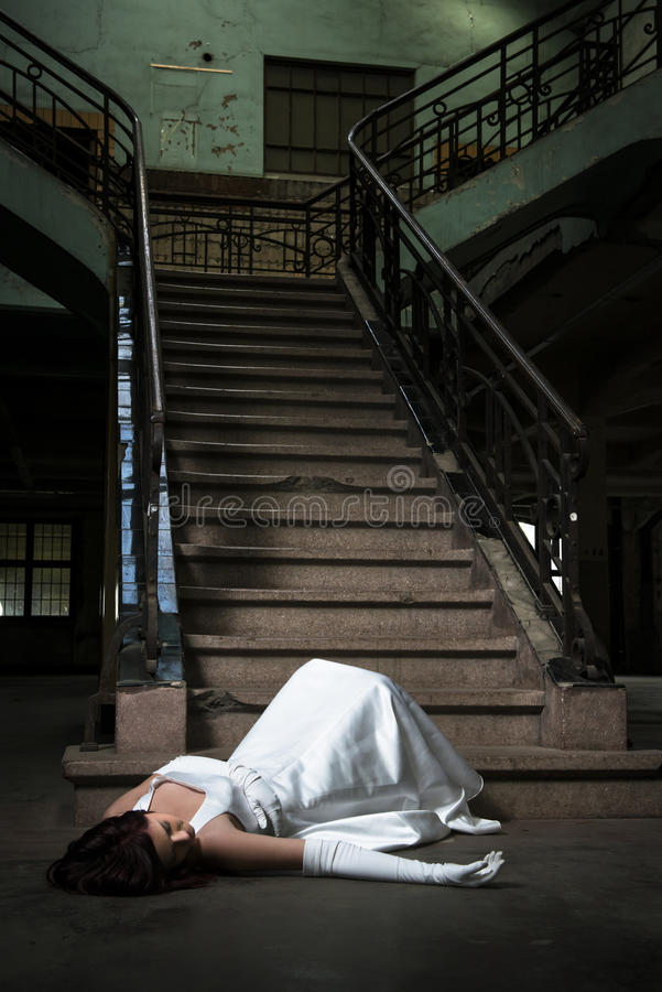 Bride fall down stairs stock photos