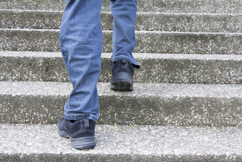 Climbing up stairs stock photography