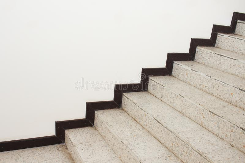 Close up Stairs terrazzo,marble floor in sideways of a wall.  royalty free stock photo