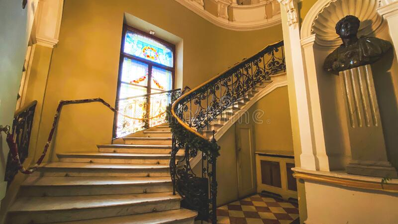 LVIV, UKRAINE - DECEMBER 7, 2019: Potocki Palace in Lviv. Stairs leading up to the next floor of a building. LVIV, UKRAINE - DECEMBER 7, 2019: Potocki Palace in royalty free stock photo