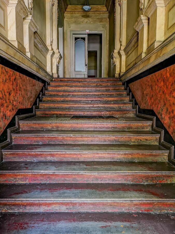 Stairs to first floor in old tenement house stock photo