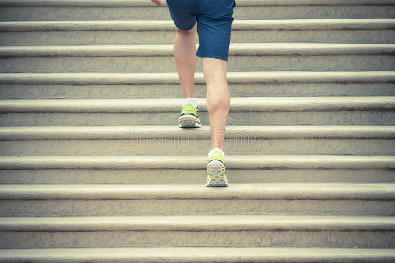 Runner athlete running up the stairs royalty free stock photography