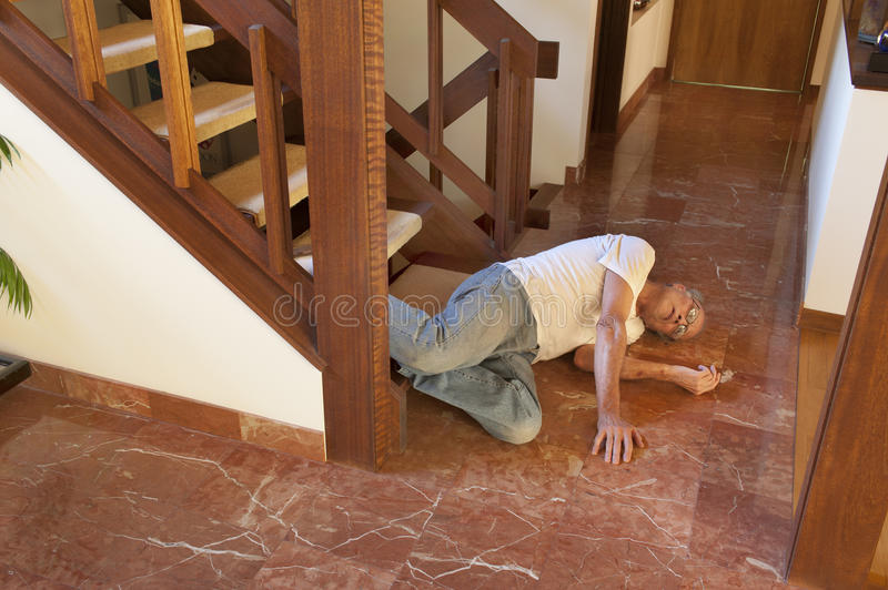 Senior man fell down the stairs stock photos