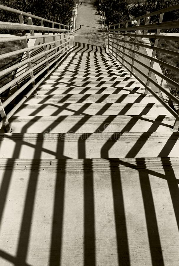 Stairs on the floor, UCSD. The shadow of the metal stairs reflecting on the floor and form artistic geometric patterns stock photo