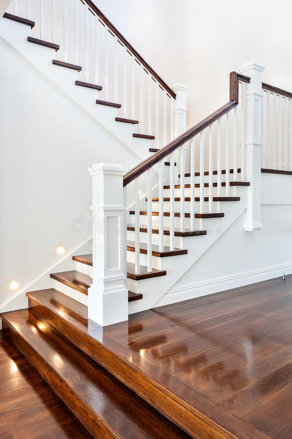Stairs and glossy wooden floor of beautiful attractive luxury ho. Use with white walls royalty free stock image